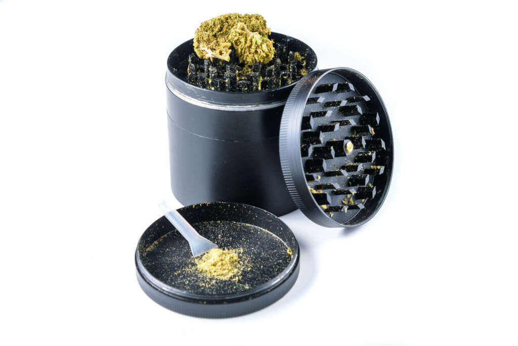 A cannabis flower grinder with a kief catcher.