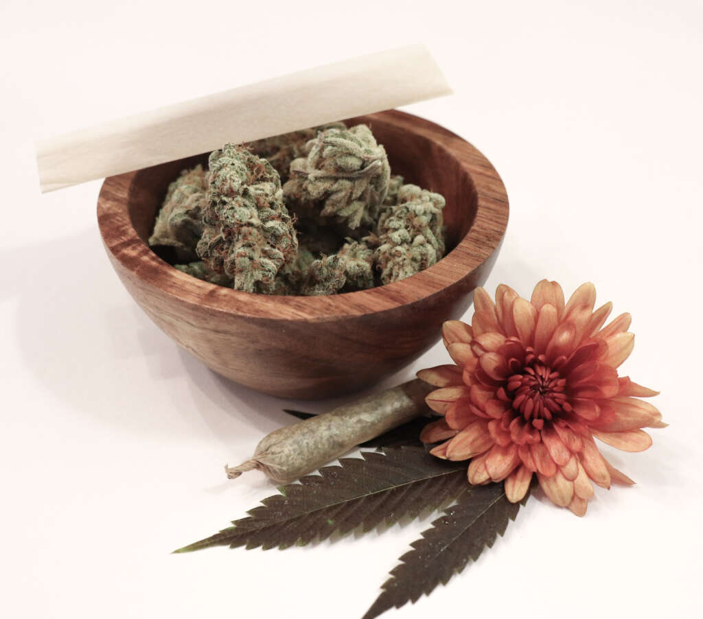 Cannabis flower & a hand-rolled joint.