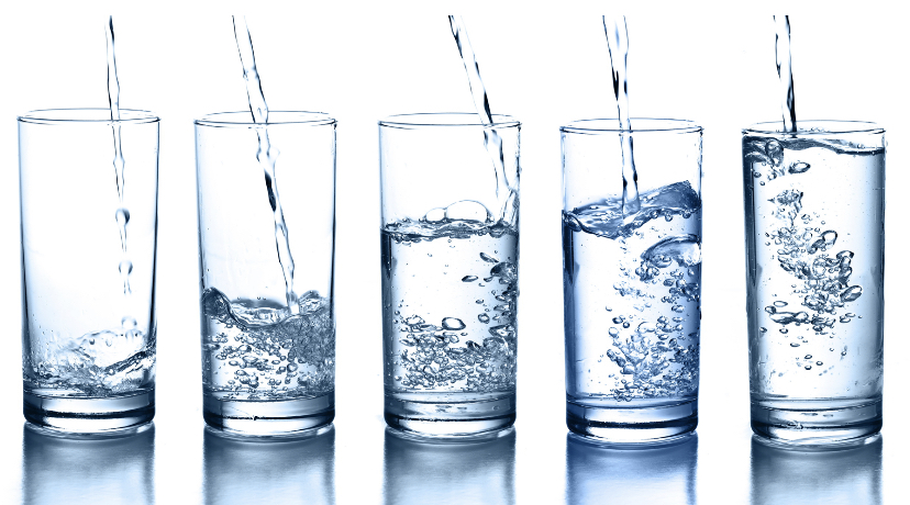 Several glasses of water.
