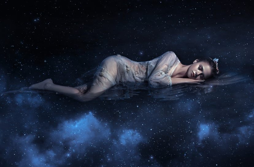 A woman floating asleep in space.
